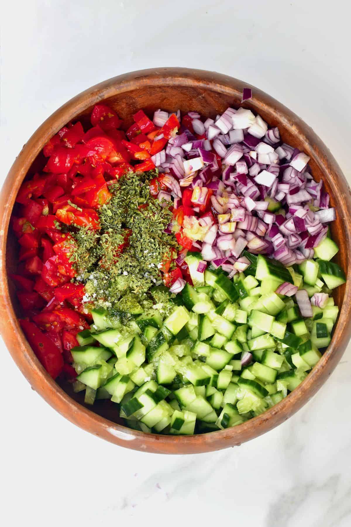 Preparing tomato cucumber salad