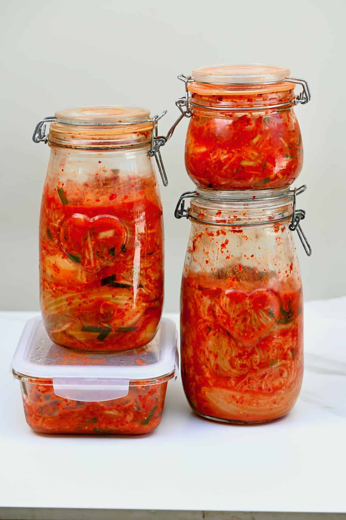 Different containers with kimchi