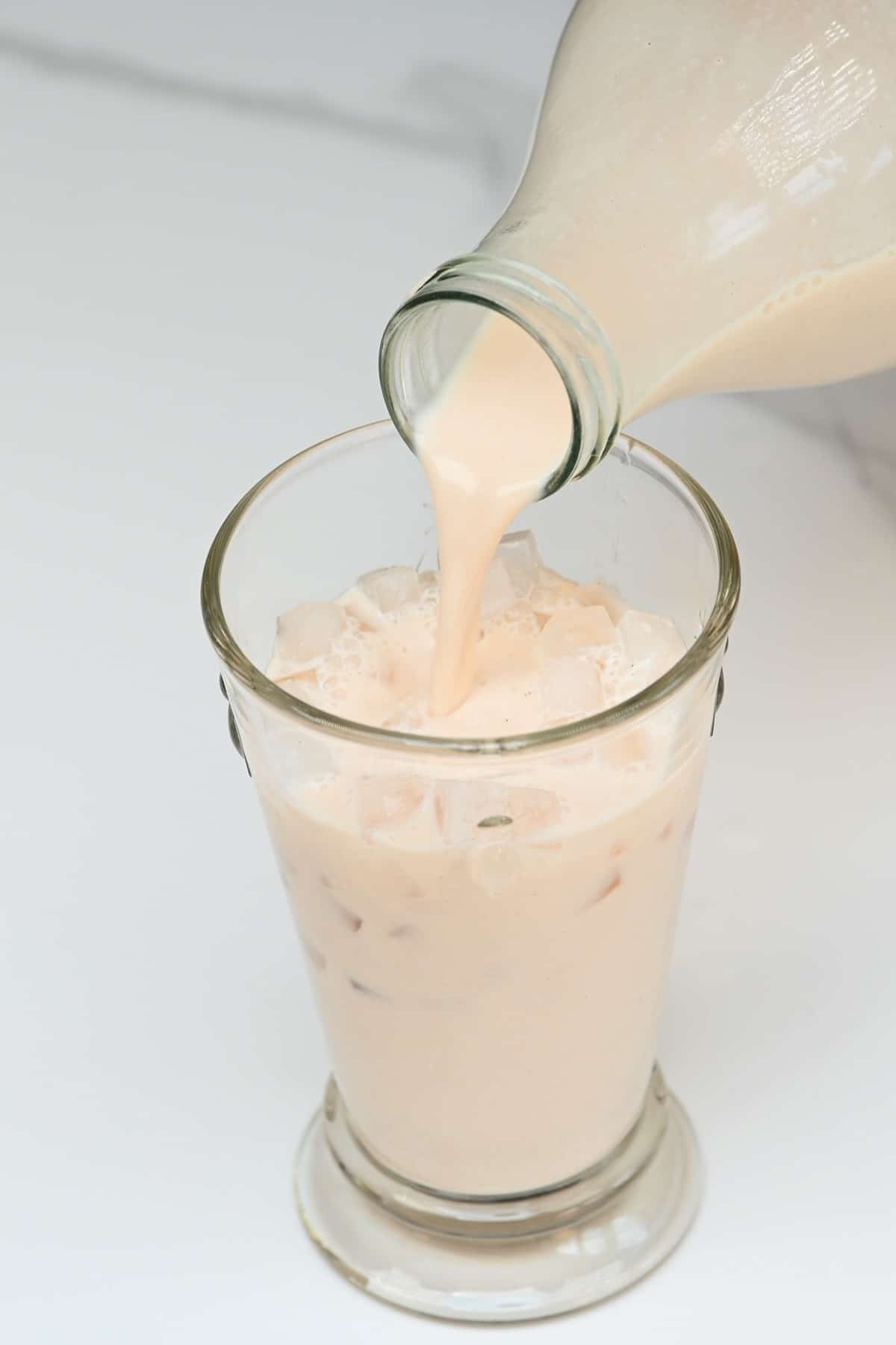 Pouring horchata in a glass