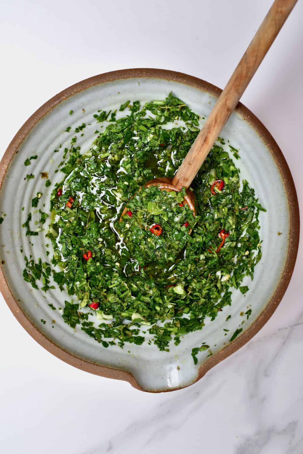 Making chimichurri in a bowl