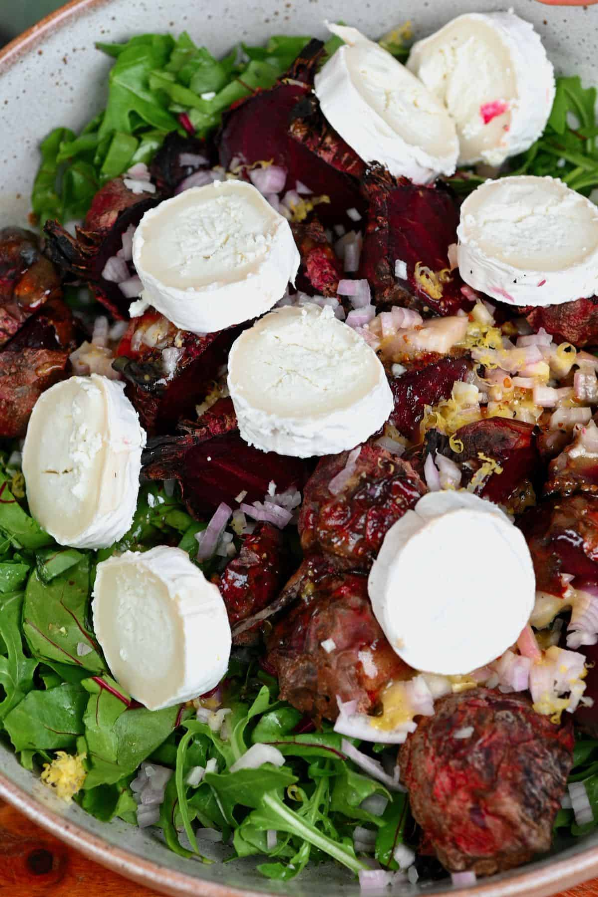 Roasted beet salad with goat cheese in a bowl