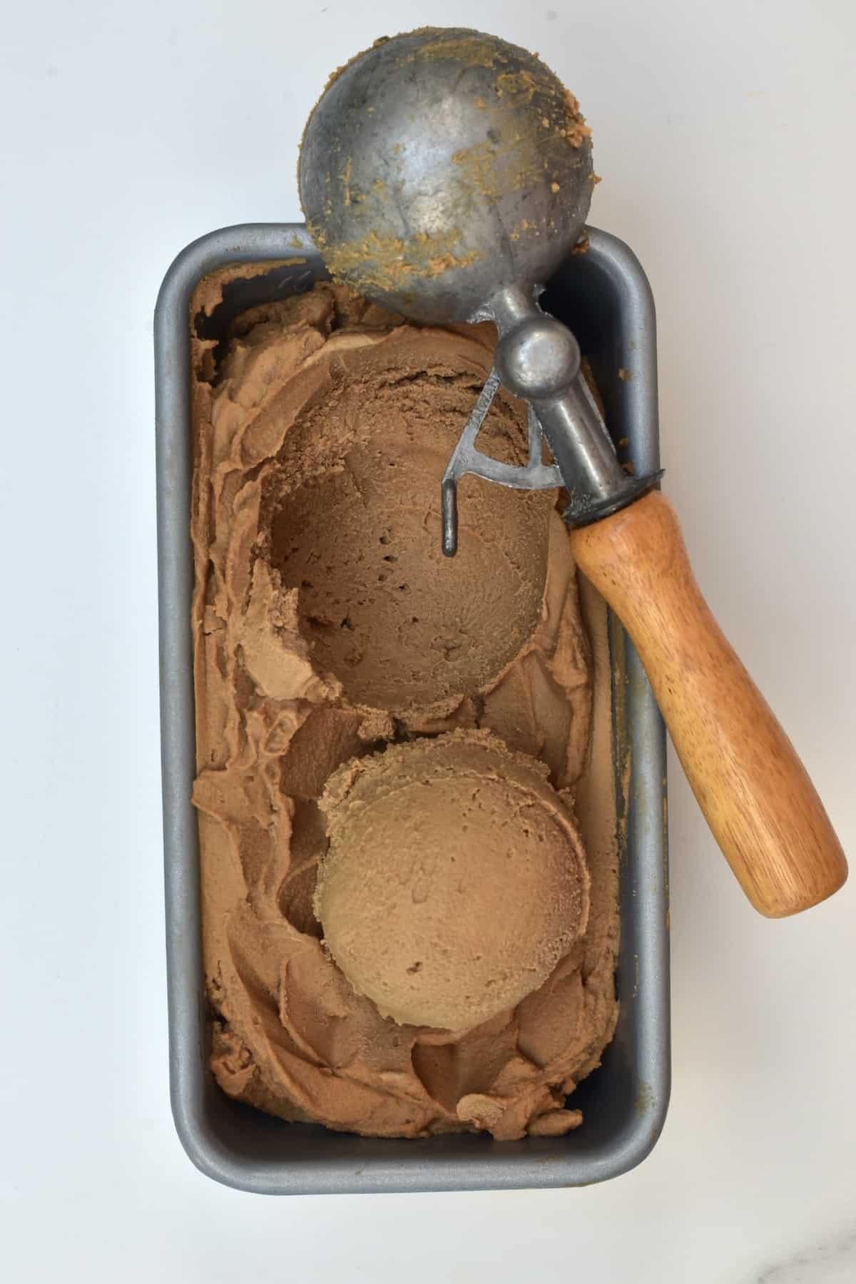 A scooper and coffee ice cream