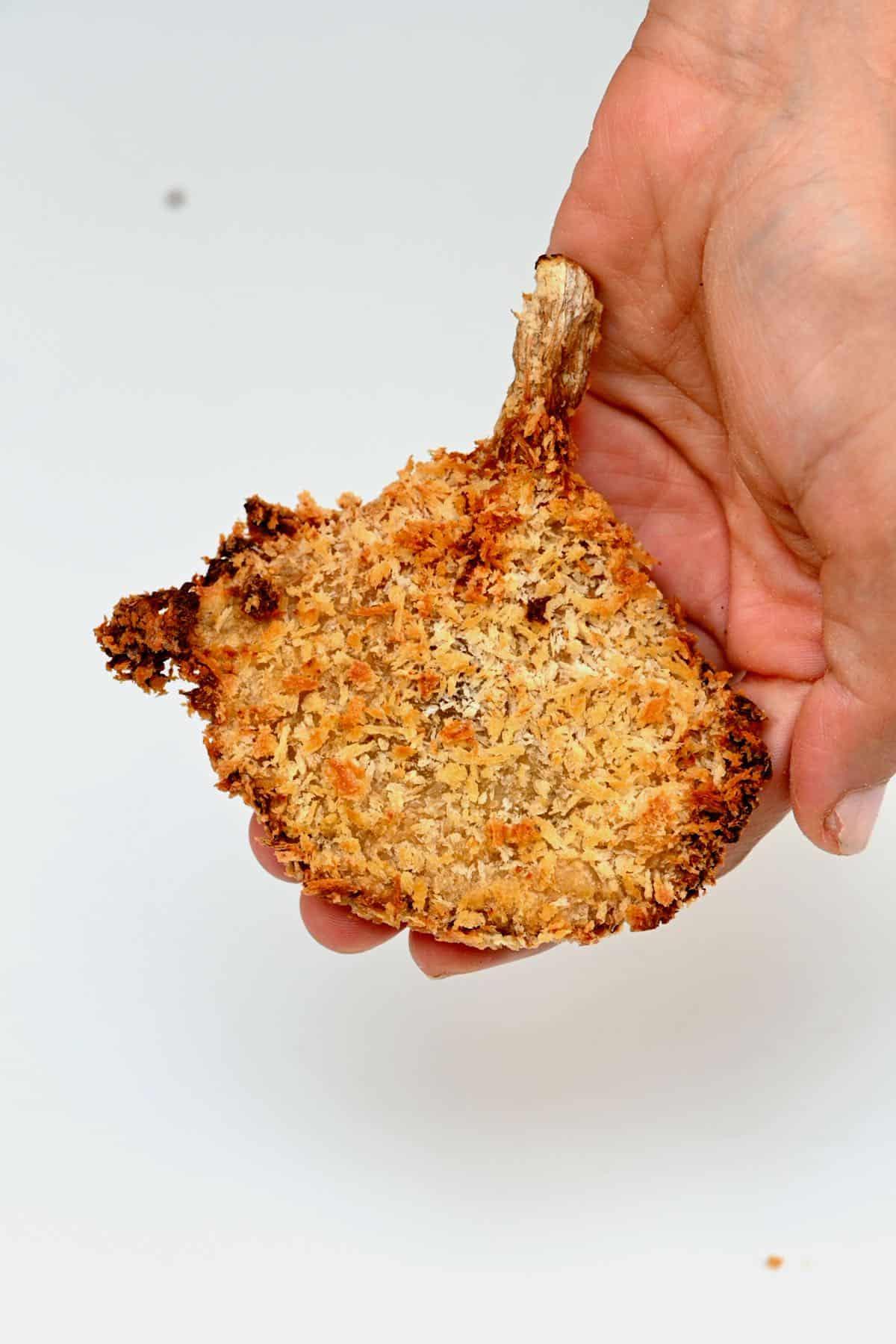 Crispy oyster mushroom in a hand