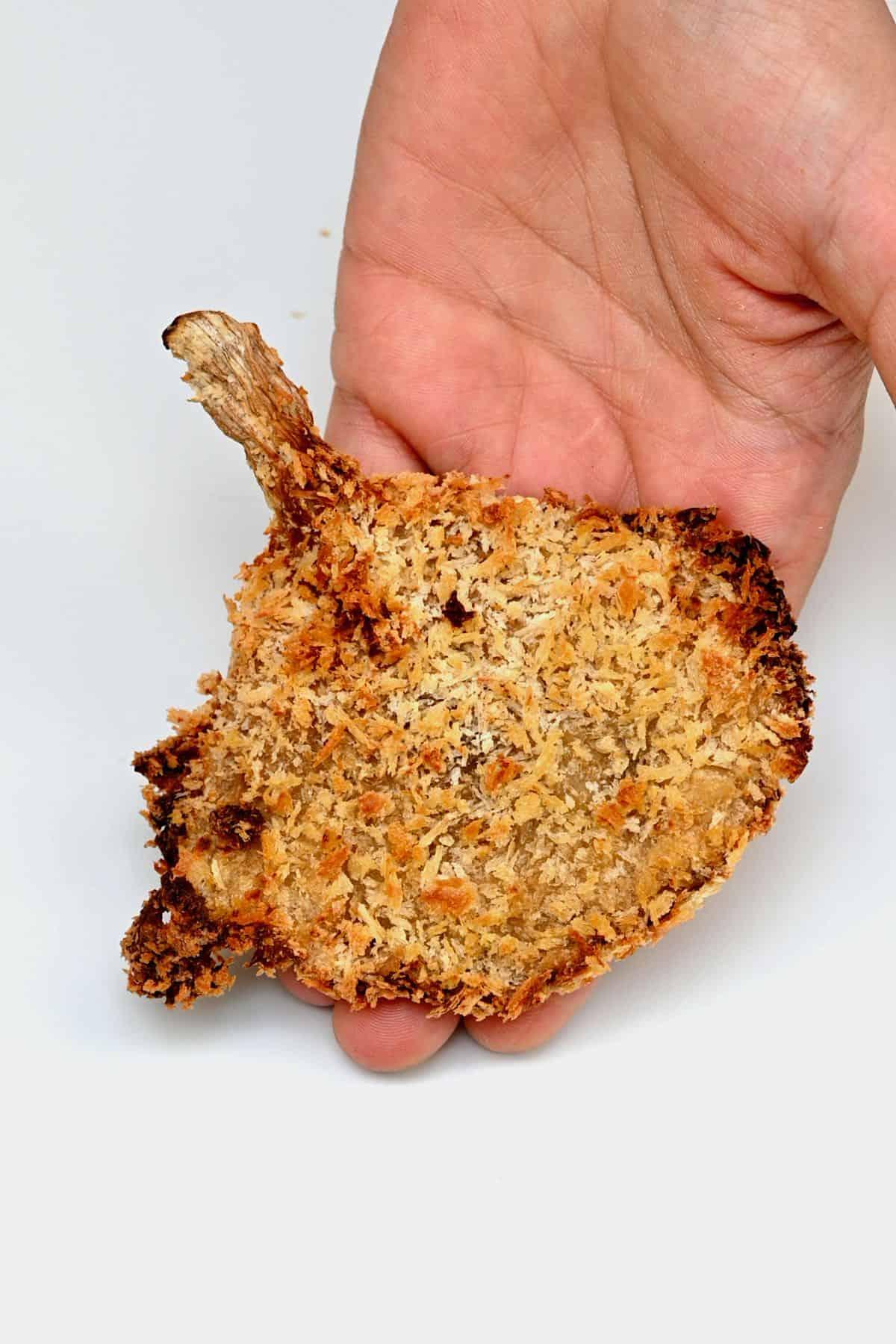 Hand holding crispy oyster mushroom
