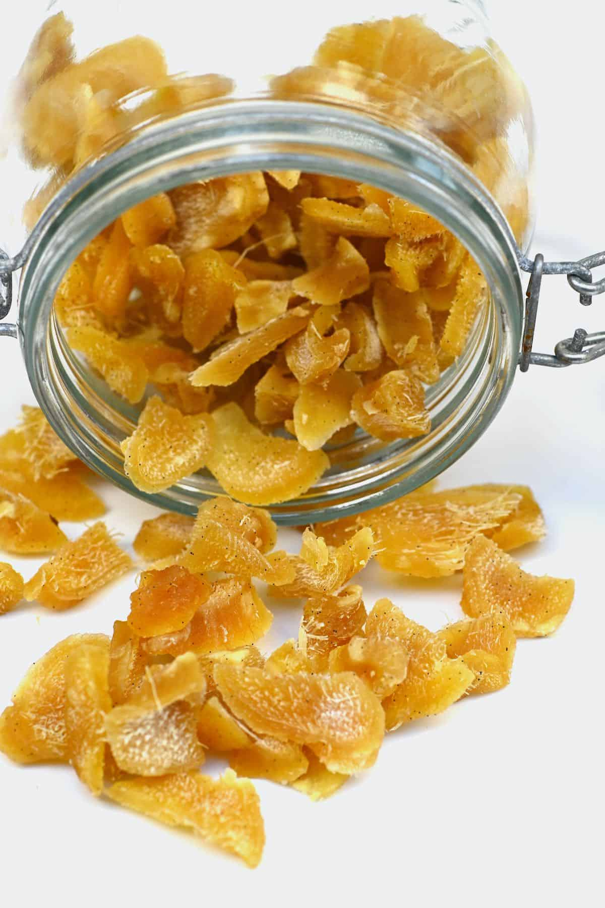 Crystallized ginger coming out of a jar
