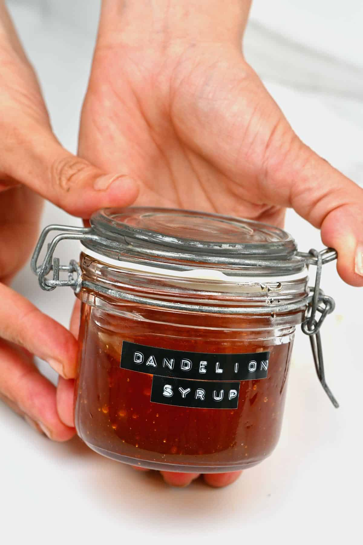 A jar with dandelion syrup