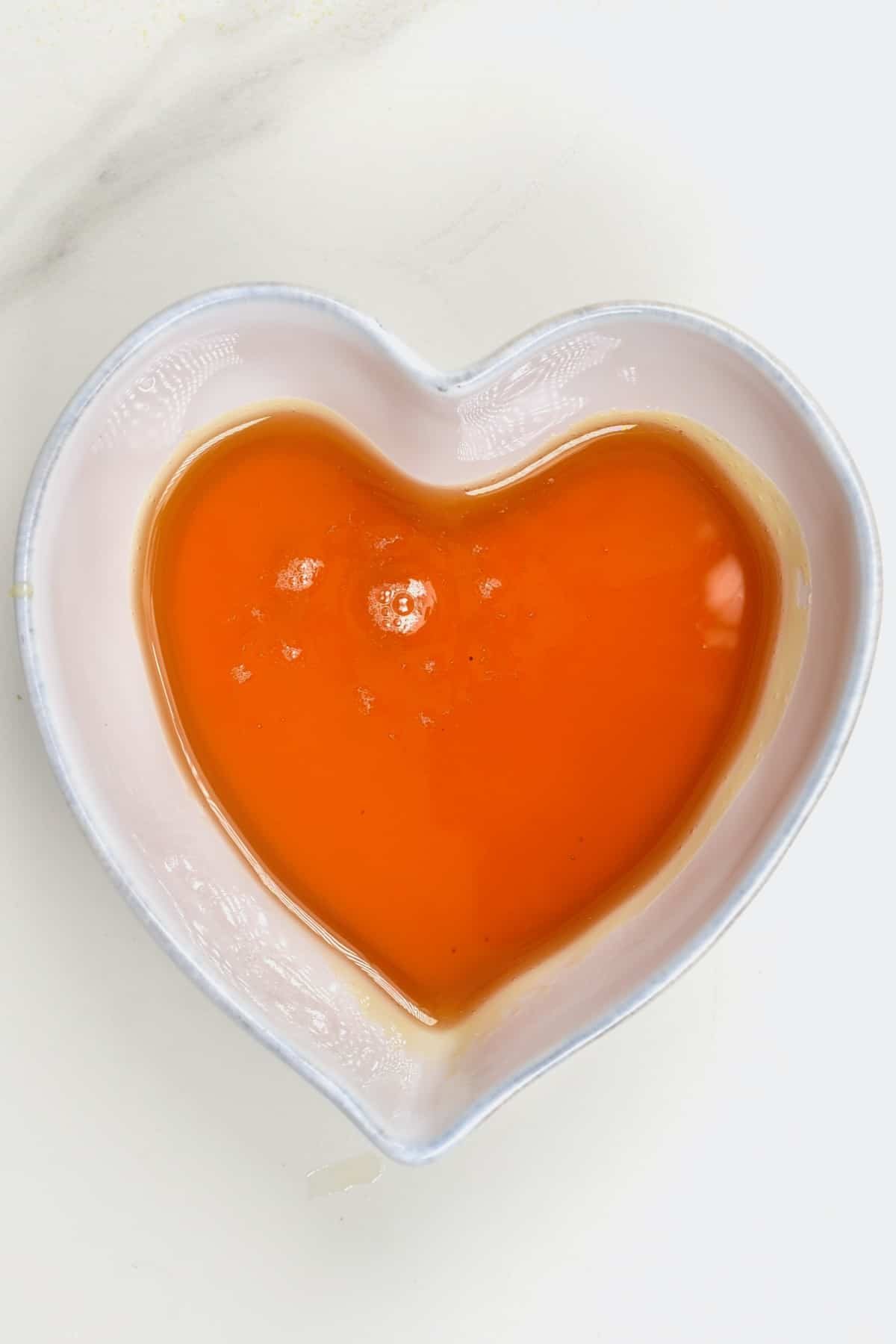 Dandelion syrup in a heart shaped bowl