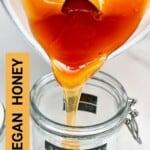 Pouring vegan dandelion honey in a jar