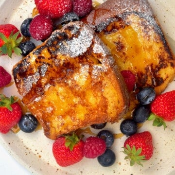 French toast with powdered sugar and fresh berries