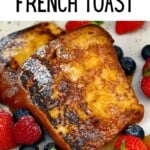 A plate with berries and french toast