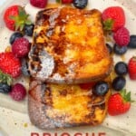 Two slices of french toast and lots of berries in a plate