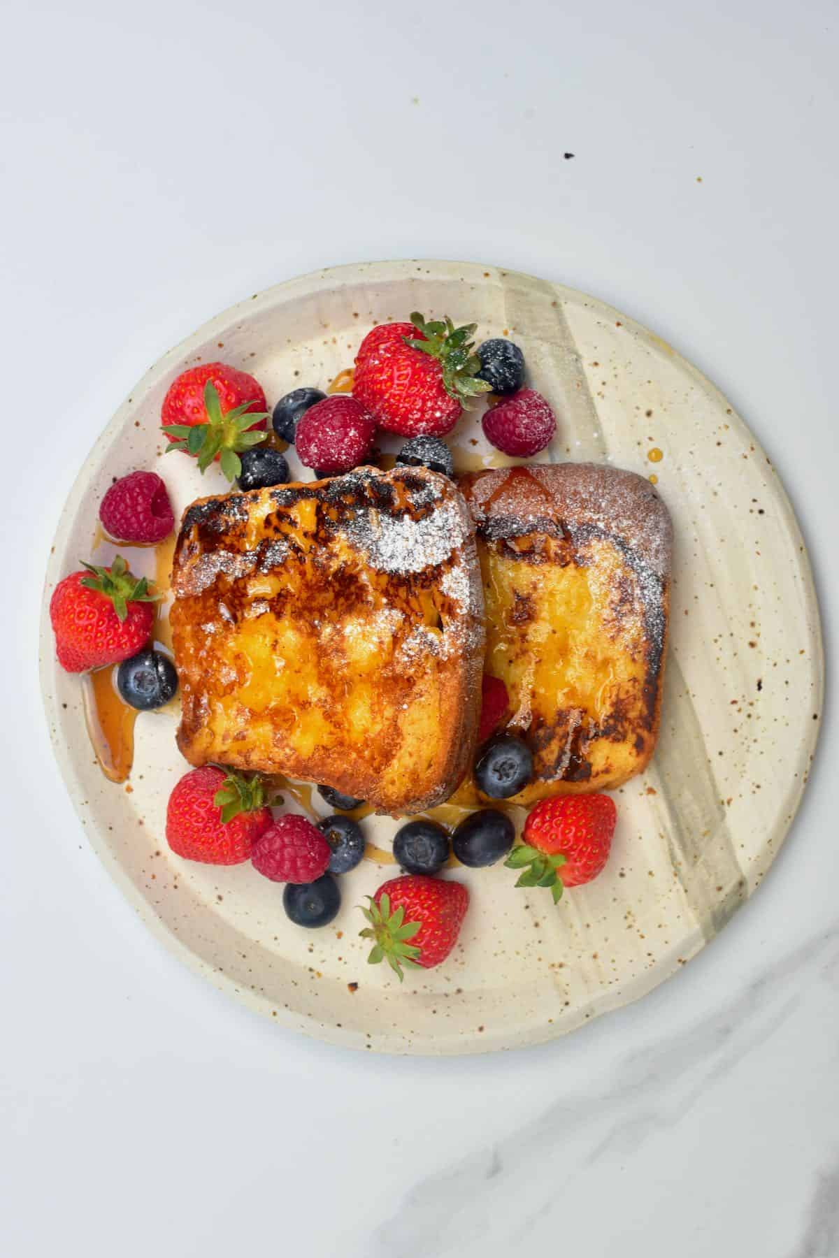 Homemade French toast with berries on a plate