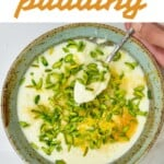 Milk ginger pudding in a bowl topped with pistachios