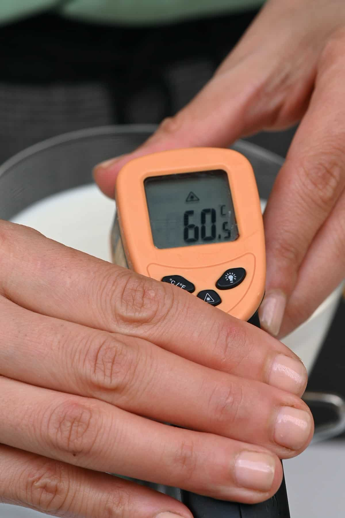 Checking the temperature of heated milk