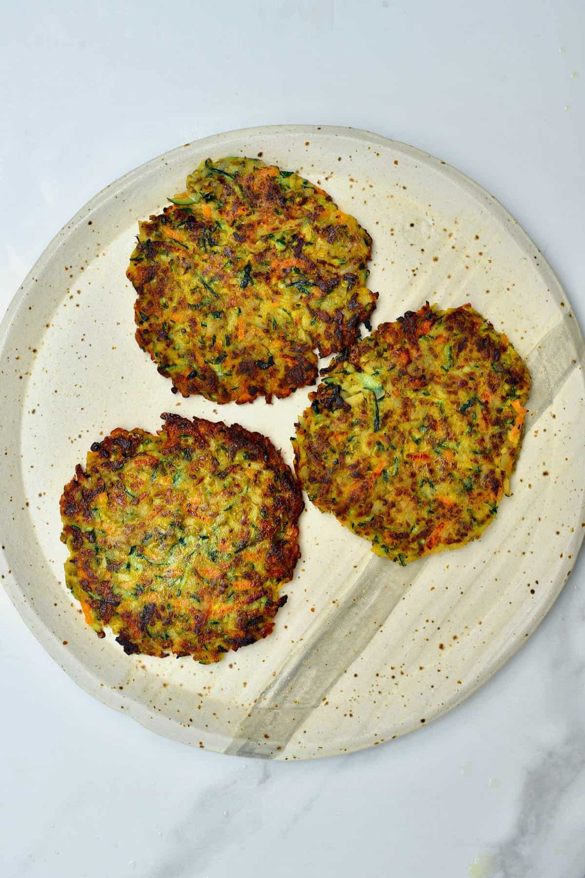 Three veggie fritters in a plate