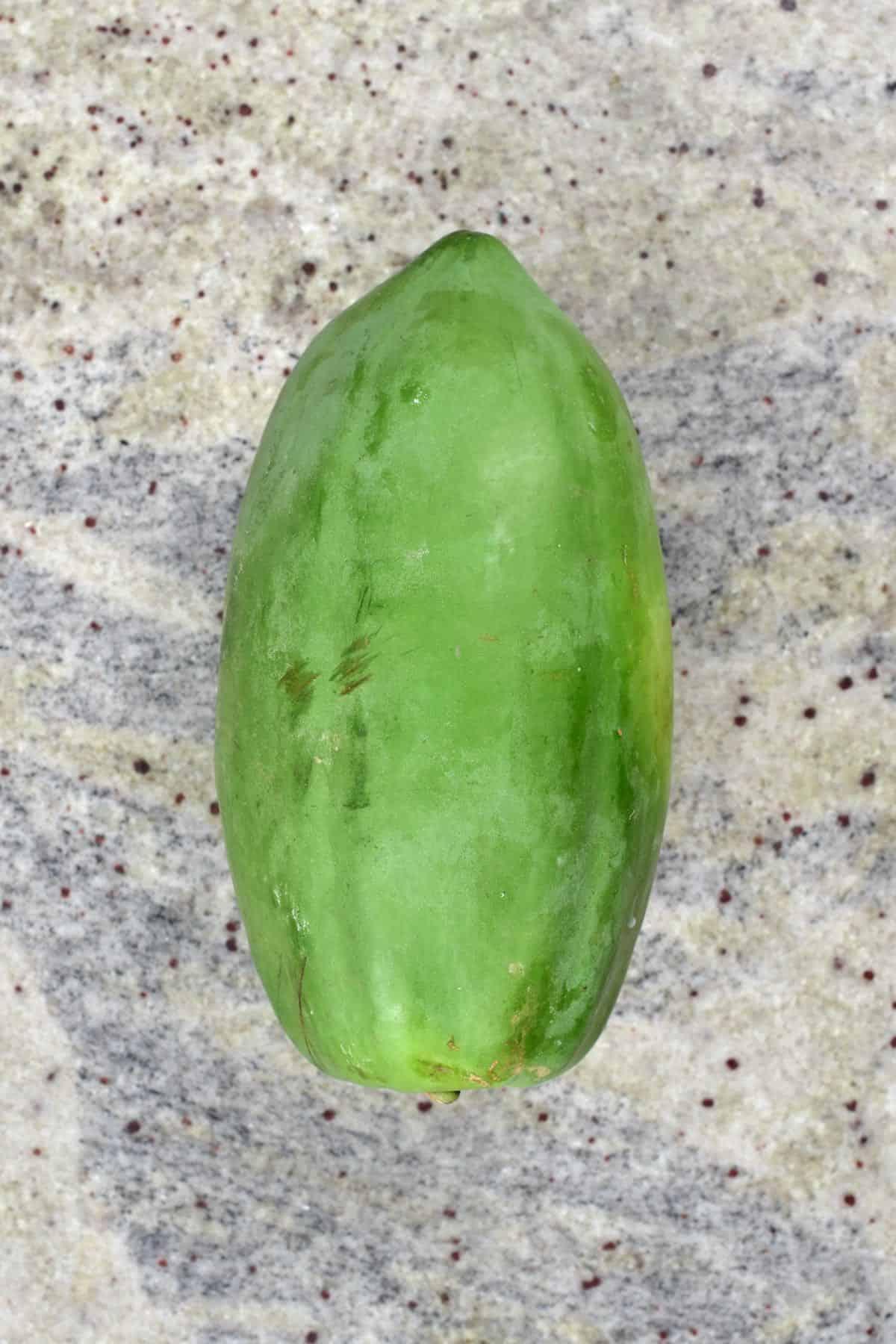 Green papaya on a flat surface