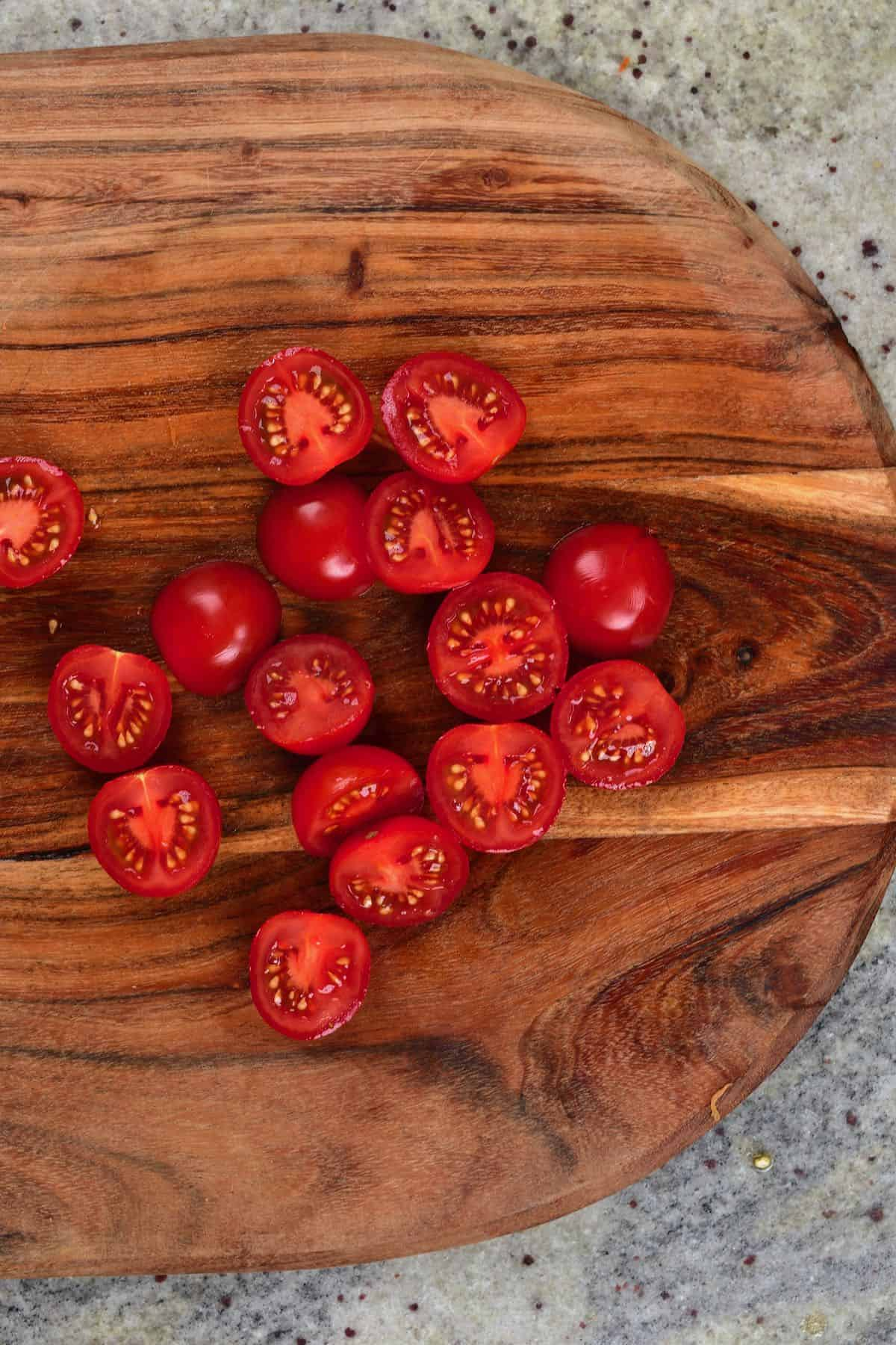 Halved tomatoes on a cutting board