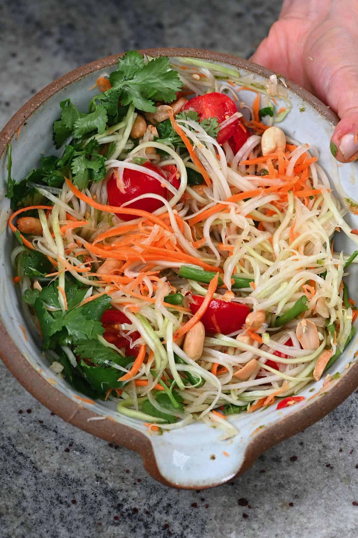 Green papaya salad in a bowl