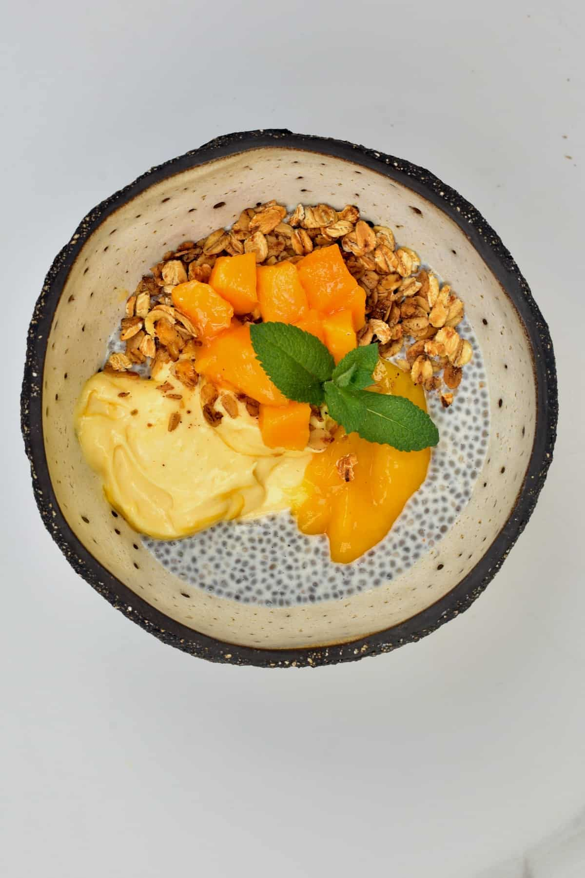 Mango breakfast topped with mint leaves