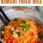 Kimchi fried rice topped with scallions in a bowl
