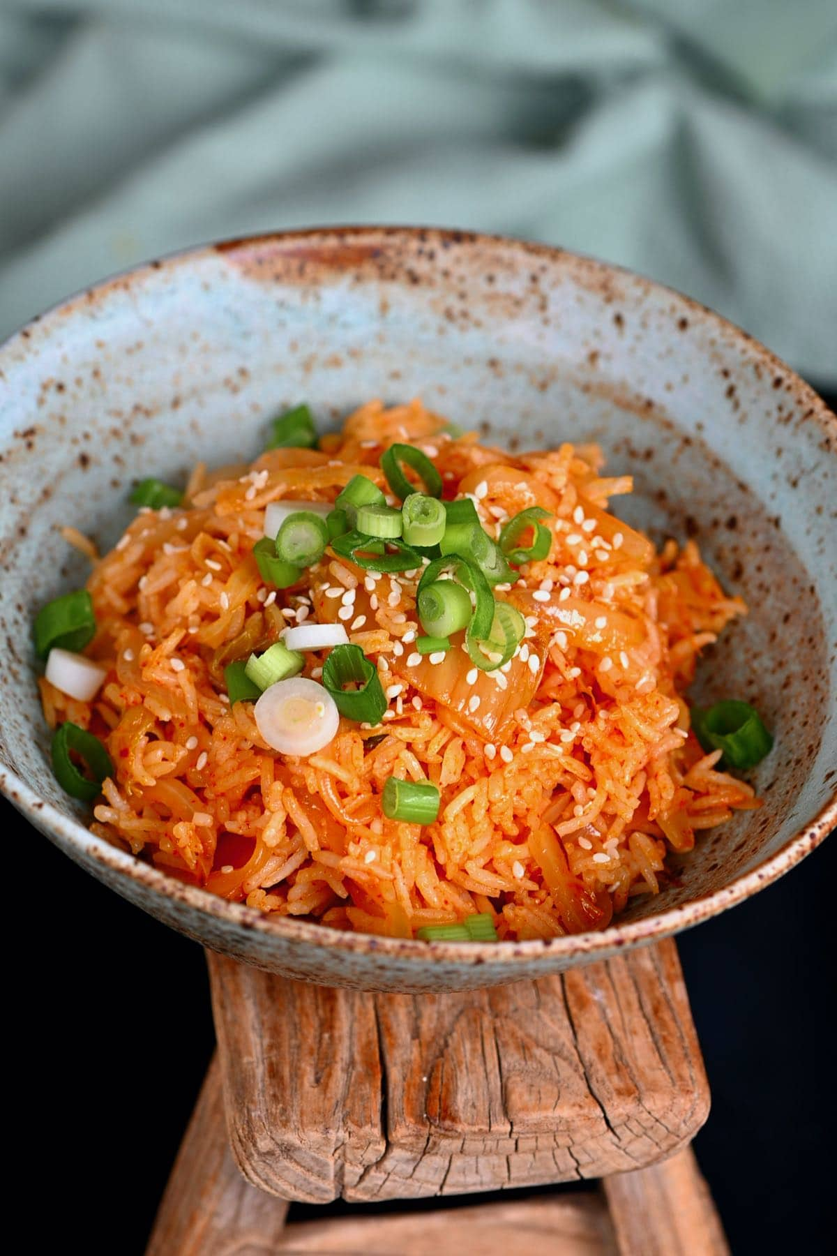Kimchi fried rice topped with green onions