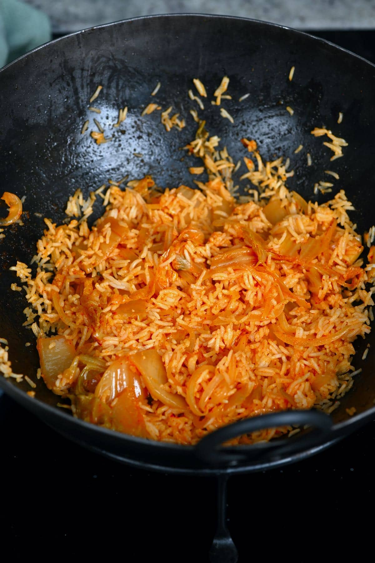 Cooking kimchi fried rice in a pan