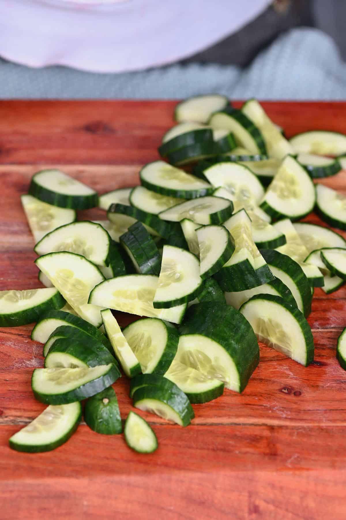 Chopped cucumber on cutting board