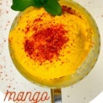 Mango ice cream topped with tajin and mint leaves