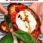 Tomato and mozzarella bruschetta with basil leaf