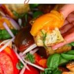 Panzanella salad topped with basil