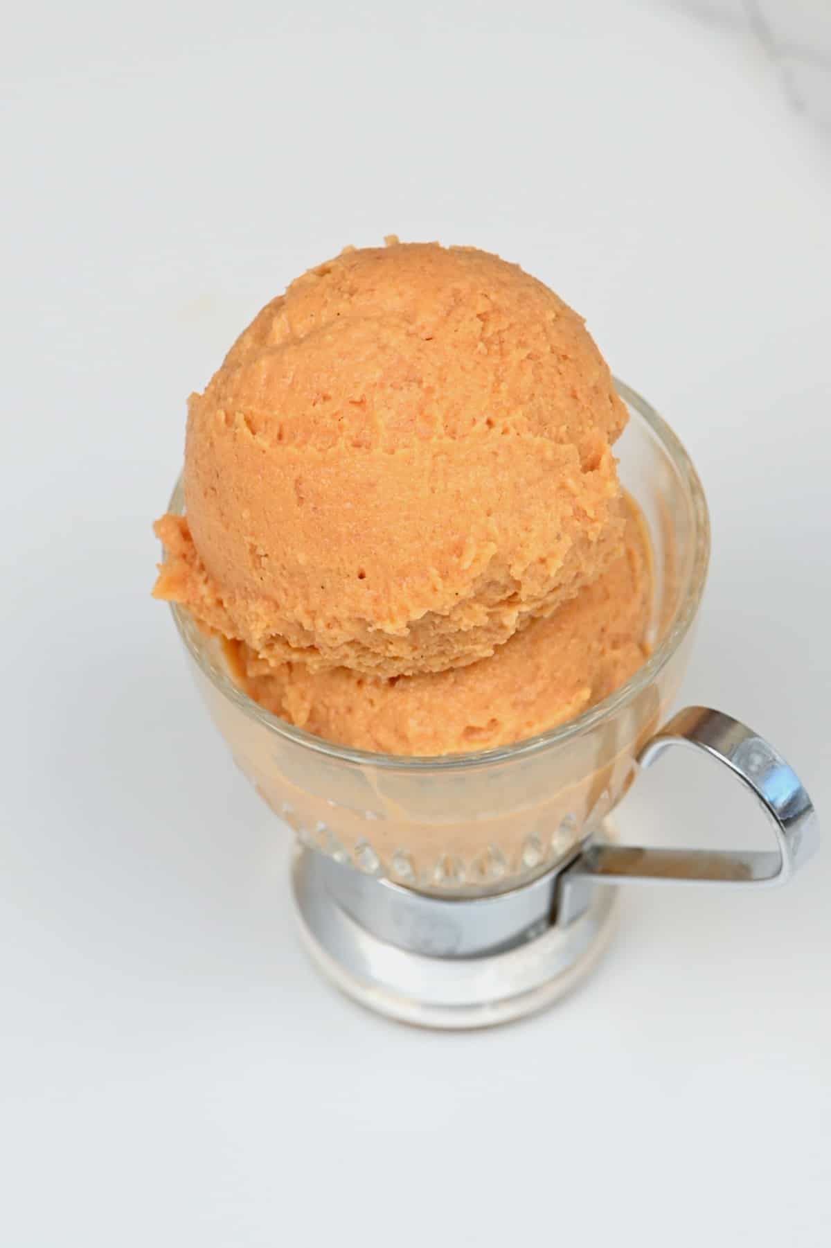 A serving of peach ice cream
