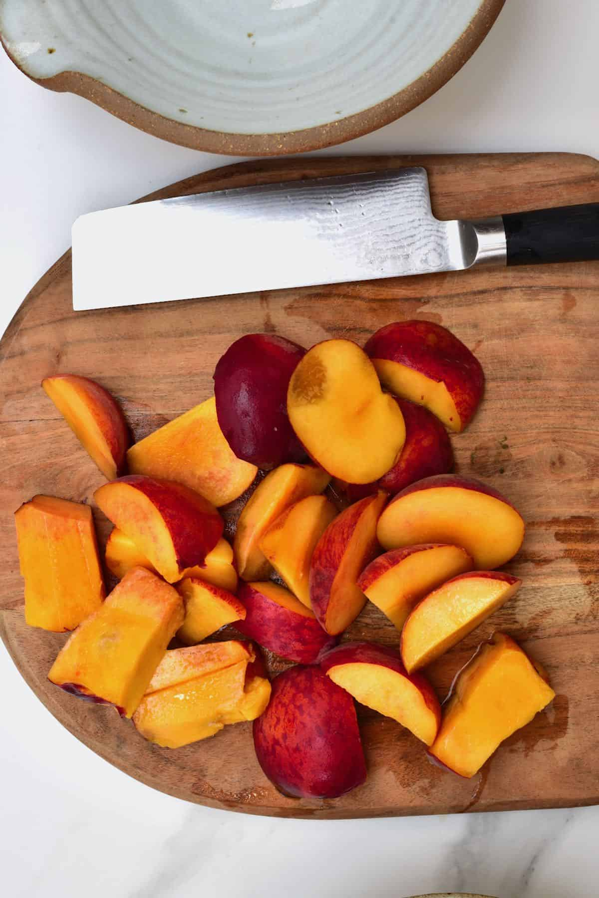 Chopped peaches on a wooden board