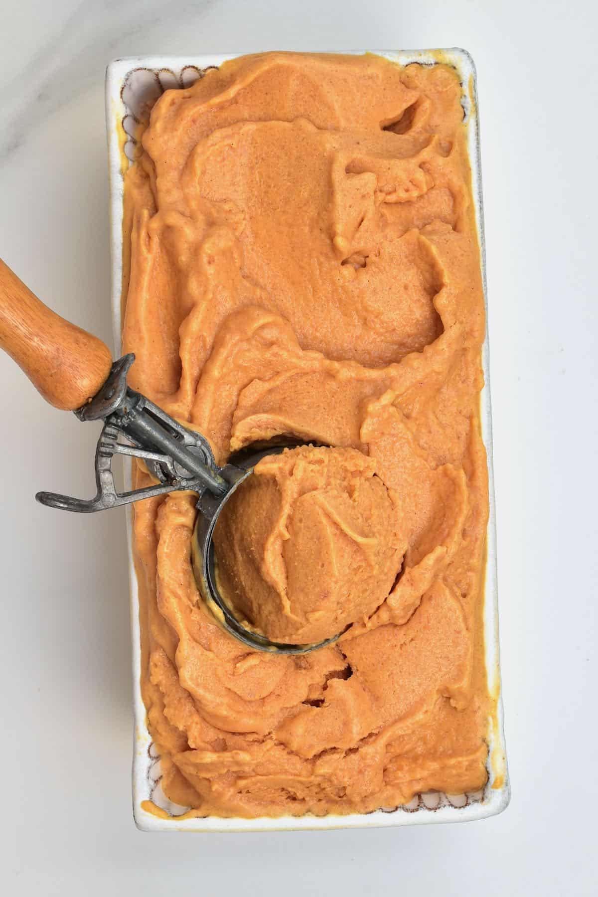 Scooping peach ice cream