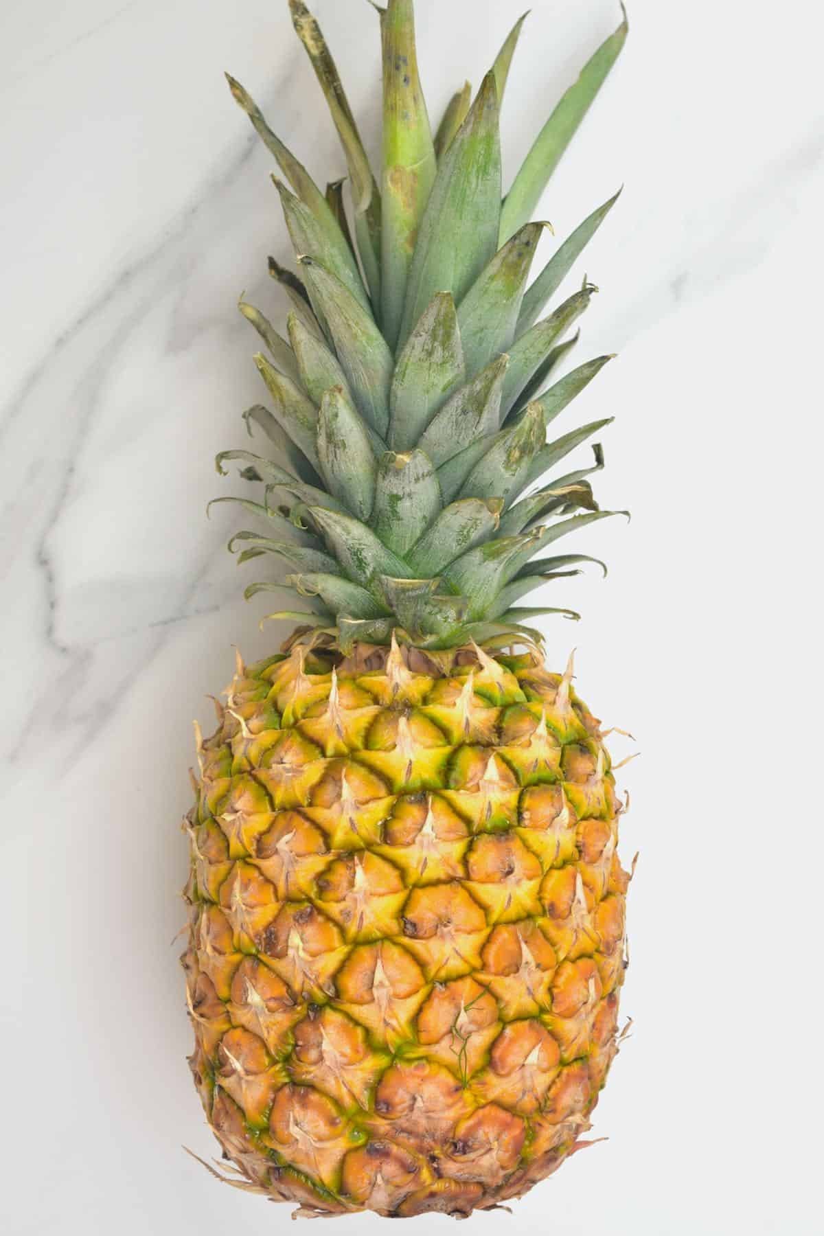 A pineapple on a flat surface