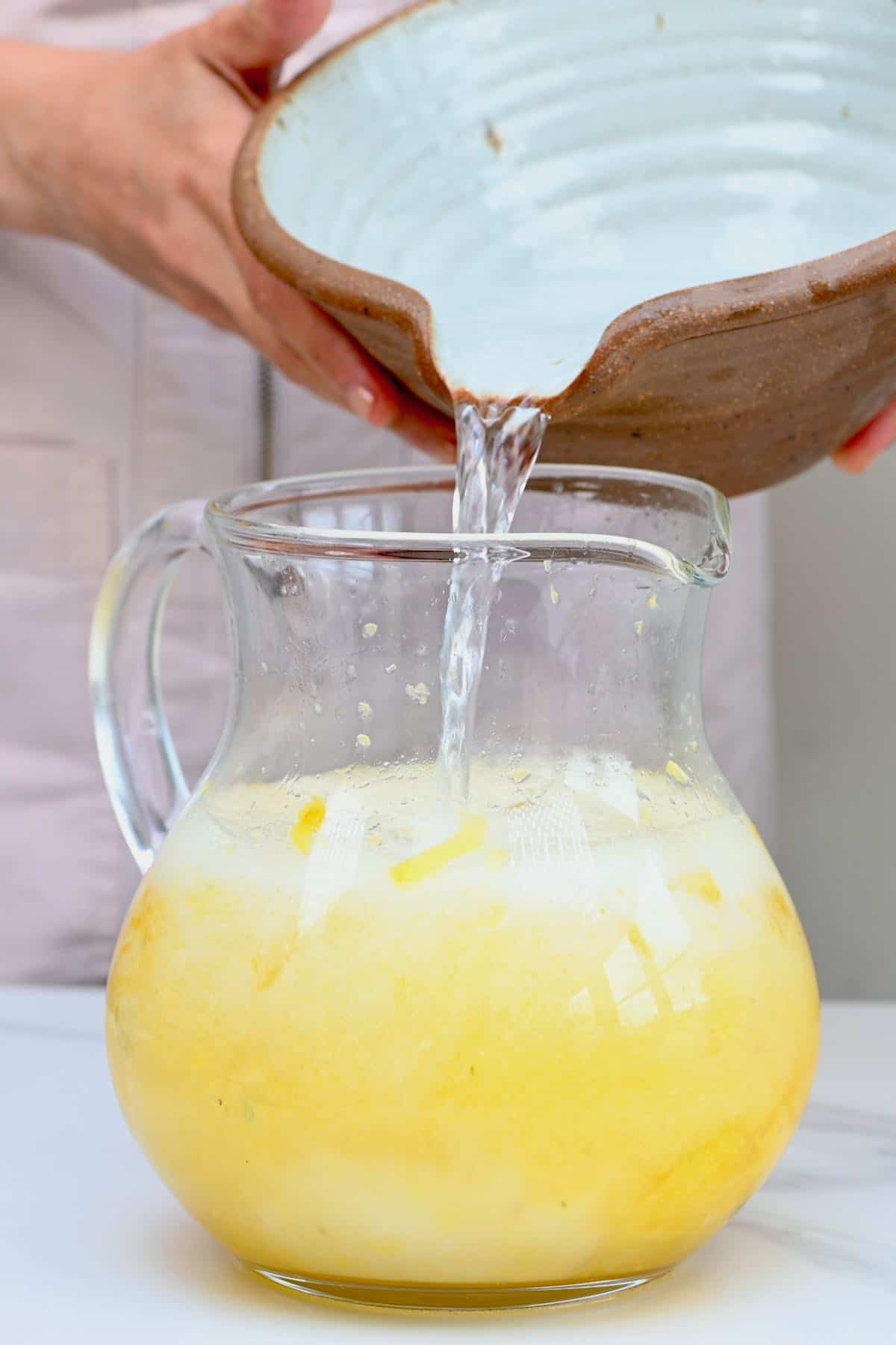 Adding water to pineapple limeade
