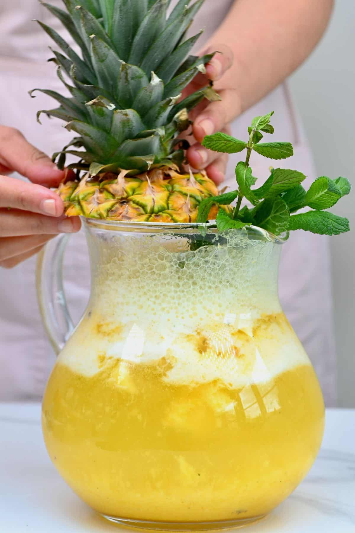 Pineapple limeade in a pitcher