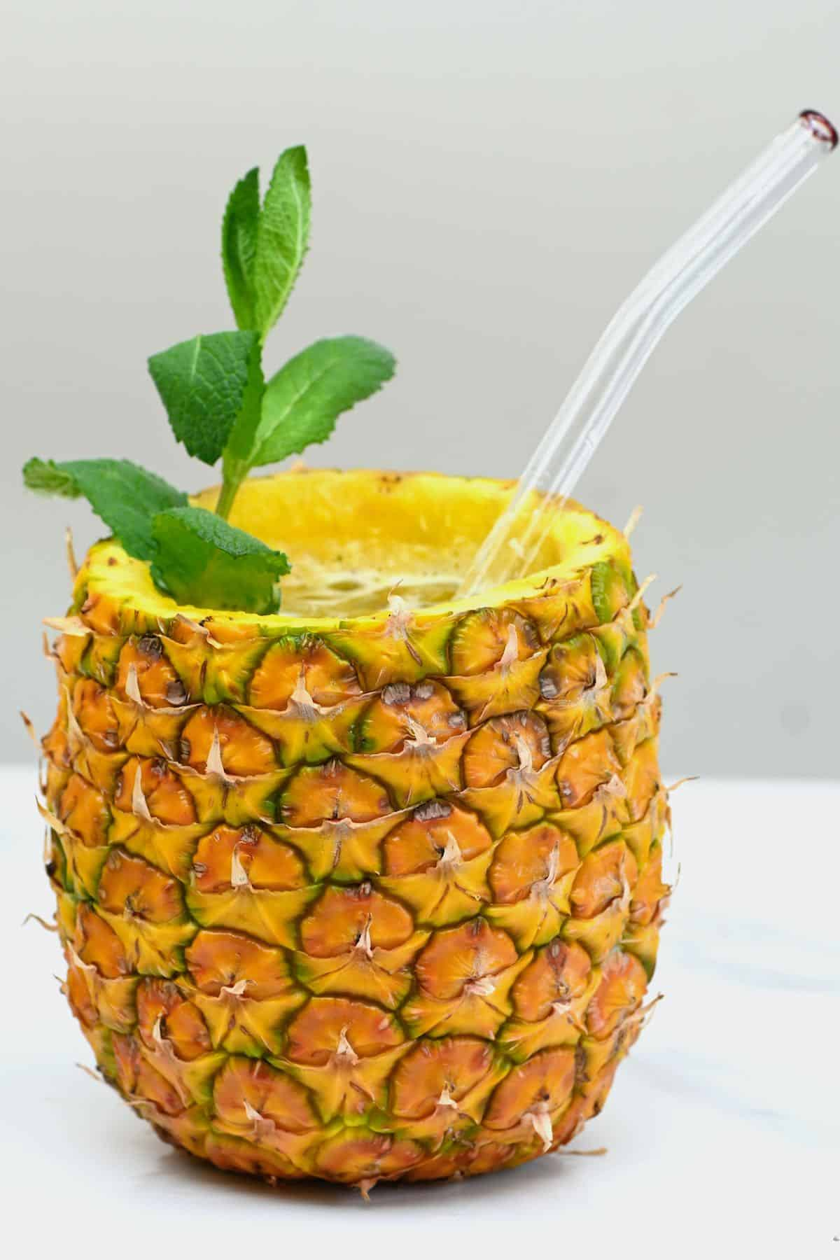 Pineapple limeade served in a pineapple