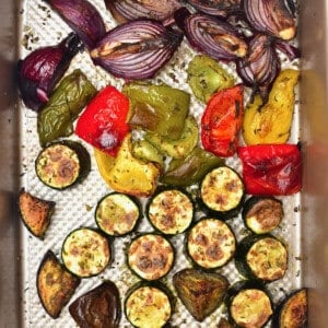 A baking tray with roasted veggies
