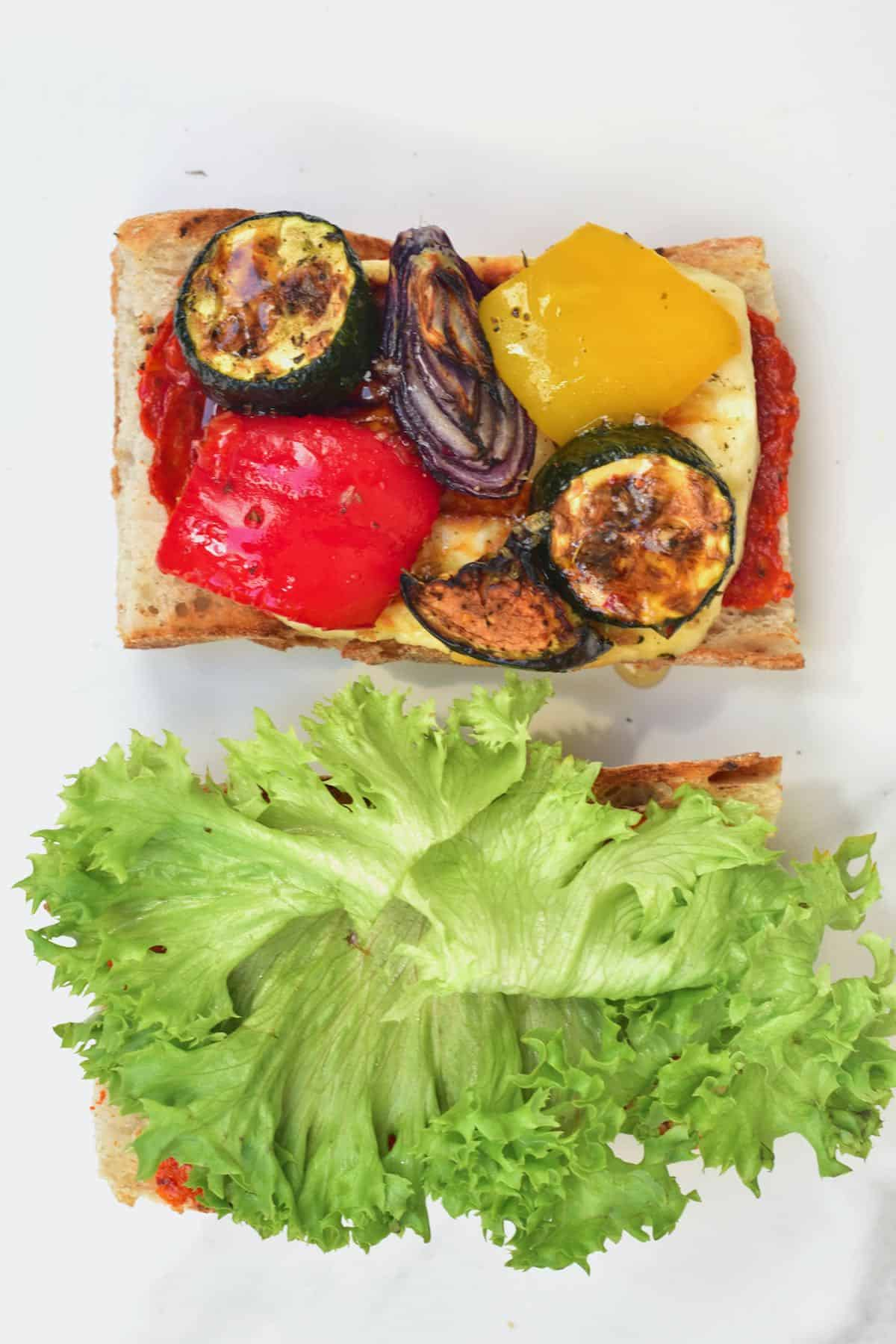A sandwich with roasted veggies