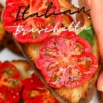 Tomato bruschetta topped with some pepper