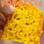 A slice of turmeric no-knead focaccia