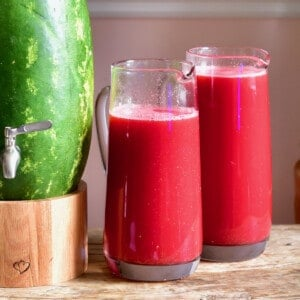 Watermelon juice in two kegs and a watermelon keg
