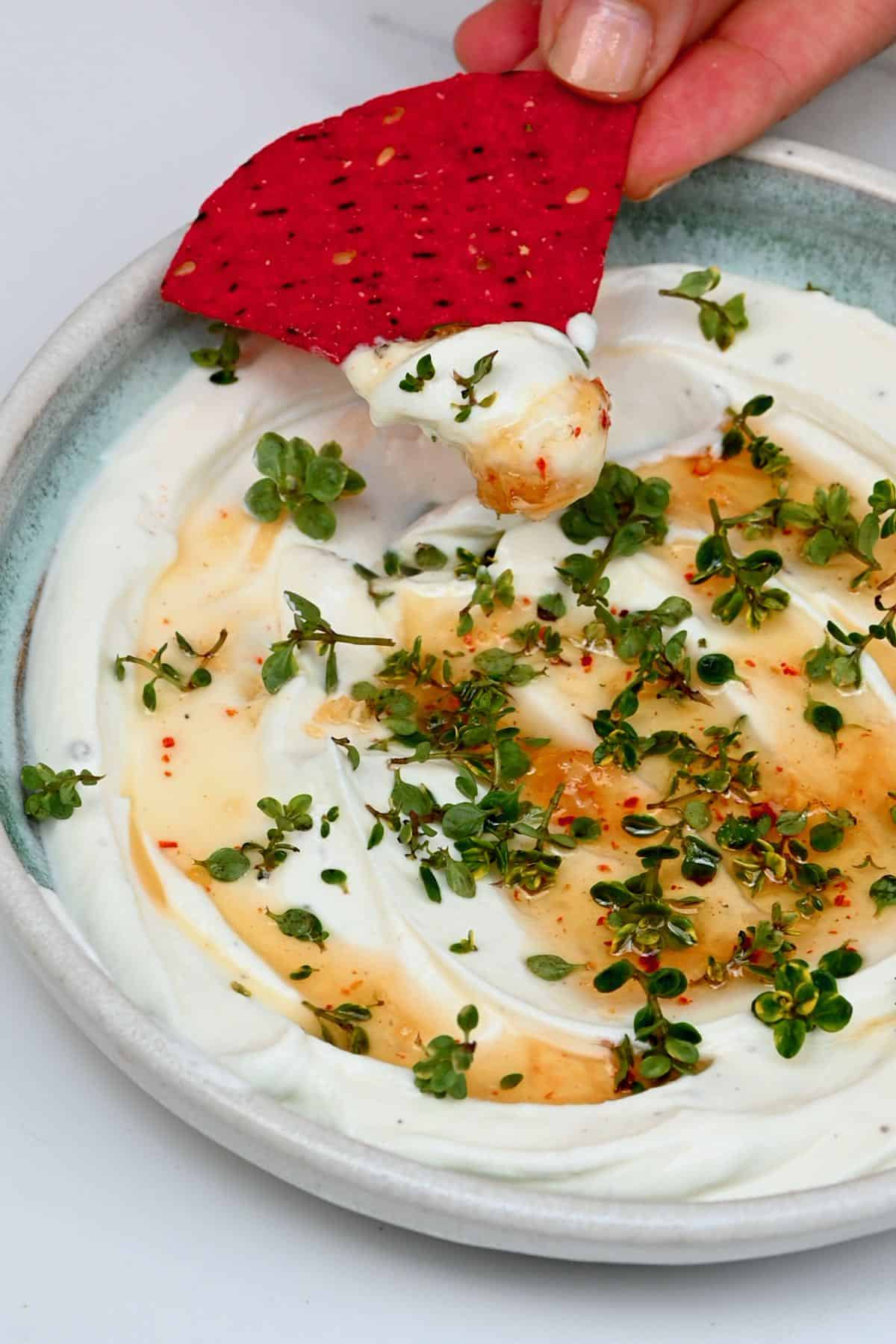 Whipped cheese topped with chili honey and thyme