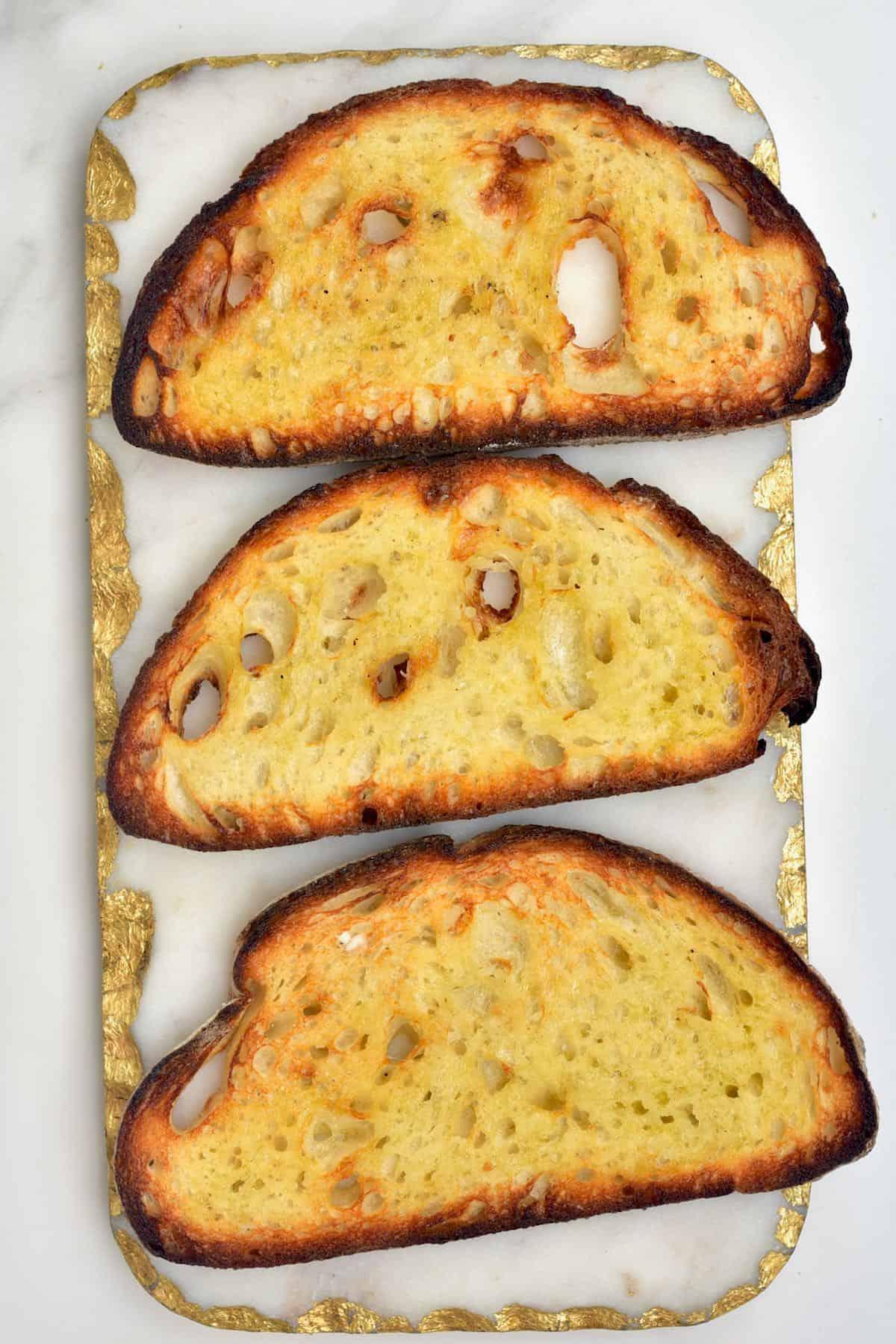 Three slices of toasted bread