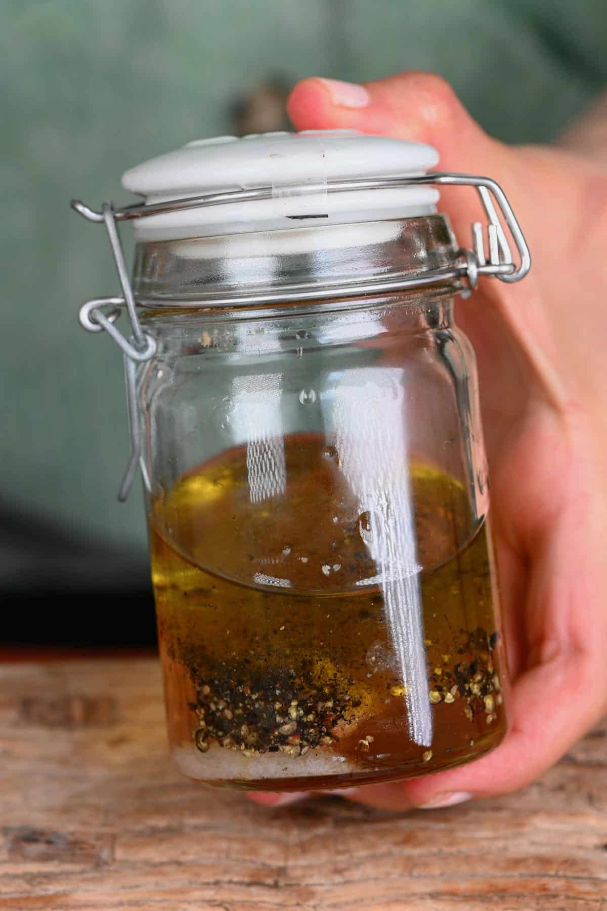 Salad dressing in a small jar ready to shake and mix