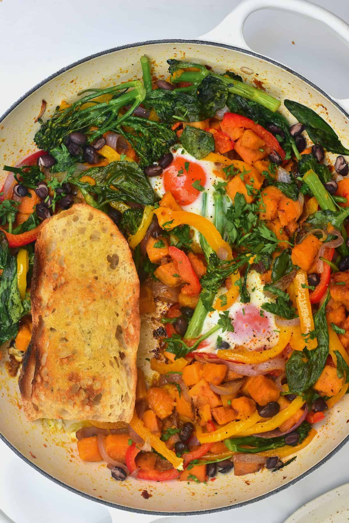 Sweet potato hash and toasted bread in a pan
