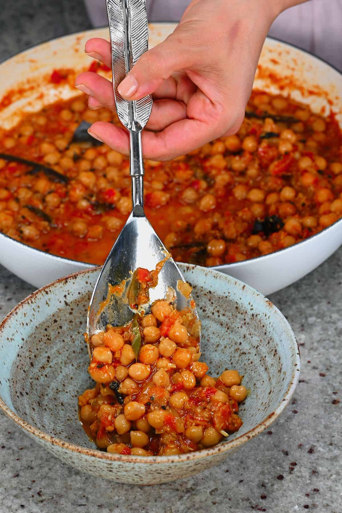 Serving chickpea curry in a bowl