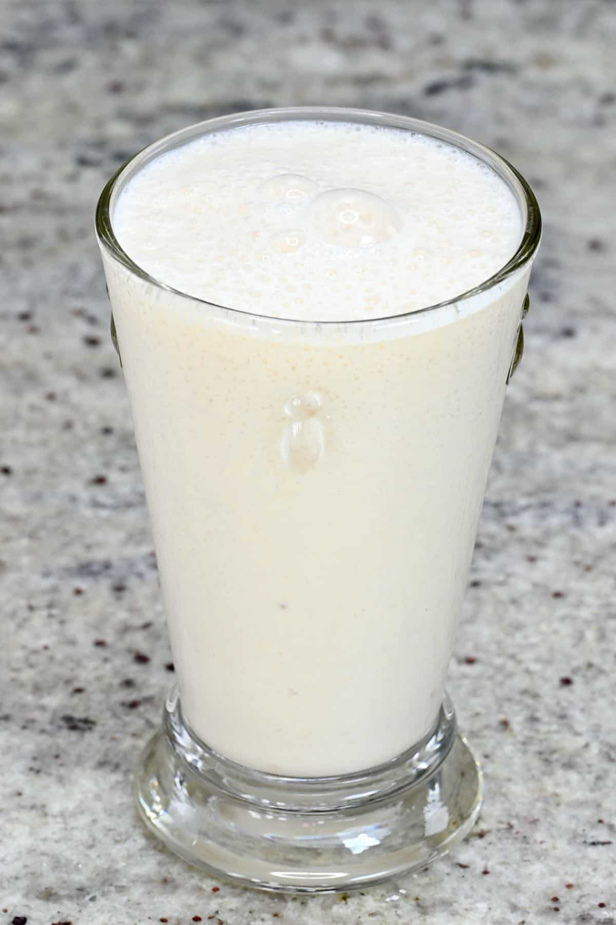 A glass with banana milkshake