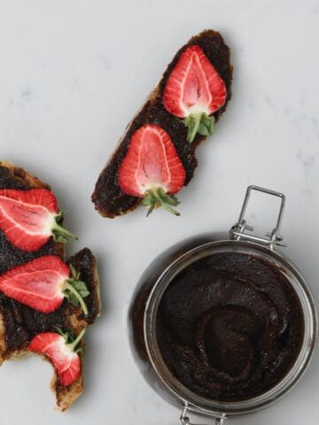 A jar with brownie batter dip and a toast with brownie batter dip
