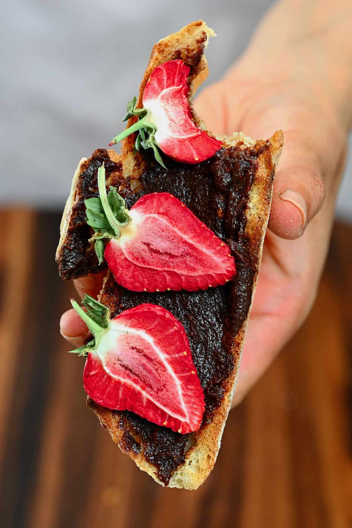 Brownie batter dip spread on toast topped with strawberries